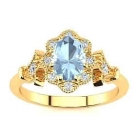 1 Carat Oval Shape Aquamarine and Halo Diamond Vintage Ring In 14 Karat Yellow Gold