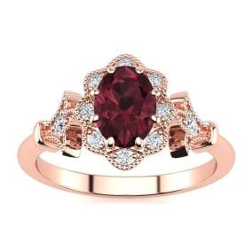 1 Carat Oval Shape Garnet and Halo Diamond Vintage Ring In 14 Karat Rose Gold