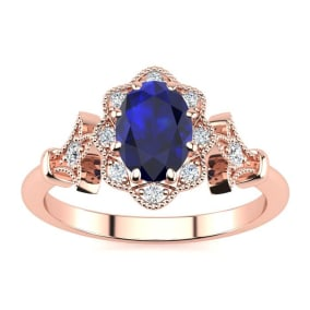 1 Carat Oval Shape Sapphire and Halo Diamond Vintage Ring In 14 Karat Rose Gold