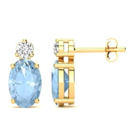 1 Carat Oval Aquamarine and Diamond Stud Earrings In 14 Karat Yellow Gold