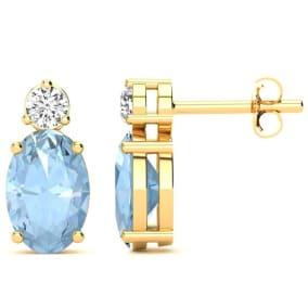 1 2/3 Carat Oval Aquamarine and Diamond Stud Earrings In 14 Karat Yellow Gold