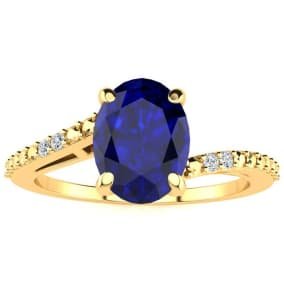 1 1/2ct Oval Shape Sapphire and Diamond Ring in 10k Yellow Gold
