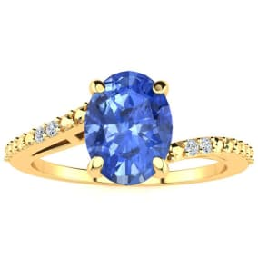 1 1/3ct Oval Shape Tanzanite and Diamond Ring in 10k Yellow Gold