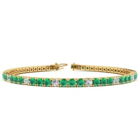 4 Carat Emerald And Diamond Graduated Tennis Bracelet In 14 Karat Yellow Gold Available In 6-9 Inch Lengths