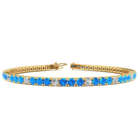4 1/3 Carat Blue Topaz And Diamond Alternating Tennis Bracelet In 14 Karat Yellow Gold Available In 6-9 Inch Lengths