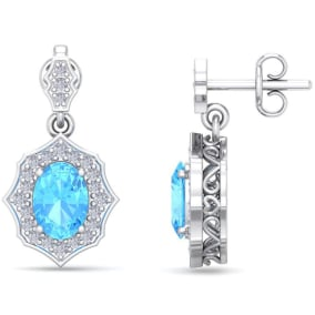 2 1/4 Carat Oval Shape Blue Topaz and Diamond Dangle Earrings In 14 Karat White Gold