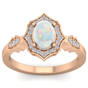 1 1/4 Carat Oval Shape Opal and Diamond Ring In 14 Karat Rose Gold