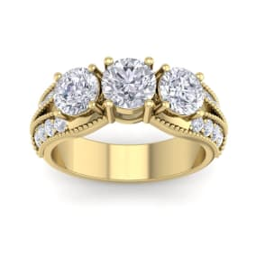 Important 3 Carat Total Diamond Weight Ring in 14 Karat Yellow Gold. This is a Large, Fantastic Diamond Ring!