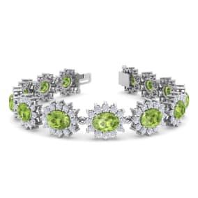22 Carat Oval Shape Peridot and Halo Diamond Bracelet In 14 Karat White Gold, 7 Inches