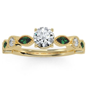 1 1/4 Carat Round and Marquise Vintage Diamond and Emerald Engagement Ring In 14 Karat Yellow Gold