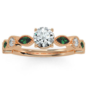 1 1/4 Carat Round and Marquise Vintage Diamond and Emerald Engagement Ring In 14 Karat Rose Gold
