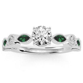 1 1/4 Carat Round and Marquise Vintage Diamond and Emerald Engagement Ring In 14 Karat White Gold