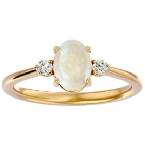 1 Carat Oval Shape Opal and Two Diamond Ring In 14 Karat Yellow Gold
