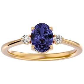 1 1/2 Carat Oval Shape Tanzanite and Two Diamond Ring In 14 Karat Yellow Gold