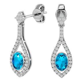 2 1/2 Carat Oval Shape Blue Topaz and Diamond Dangle Earrings In 14 Karat White Gold