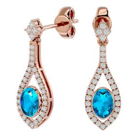 2 1/2 Carat Oval Shape Blue Topaz and Diamond Dangle Earrings In 14 Karat Rose Gold