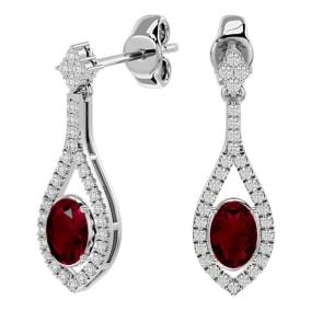 2 1/2 Carat Oval Shape Ruby and Diamond Dangle Earrings In 14 Karat White Gold