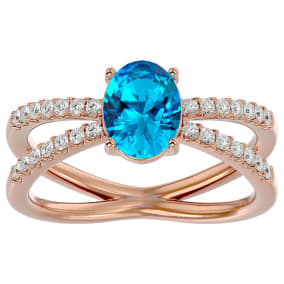 1 3/4 Carat Oval Shape Blue Topaz and Diamond Ring In 14 Karat Rose Gold