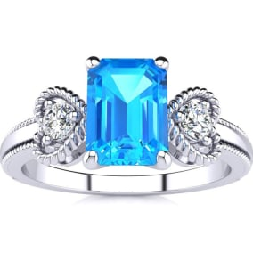 1 1/3 Carat Blue Topaz and Two Diamond Heart Ring In 1.4 Karat White Gold™