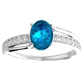 1 3/4 Carat Oval Shape Blue Topaz and Diamond Ring In 14 Karat White Gold