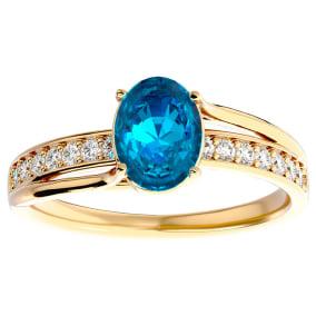1 3/4 Carat Oval Shape Blue Topaz and Diamond Ring In 14 Karat Yellow Gold