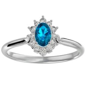 2/3 Carat Oval Shape Blue Topaz and Halo Diamond Ring In 14 Karat White Gold