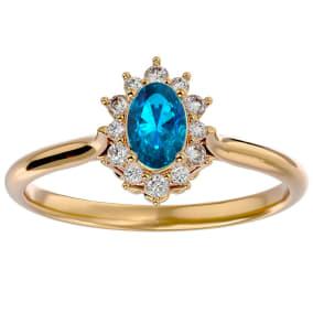 2/3 Carat Oval Shape Blue Topaz and Halo Diamond Ring In 14 Karat Yellow Gold