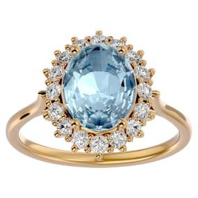 2 3/4 Carat Oval Shape Aquamarine and Halo Diamond Ring In 14 Karat Yellow Gold