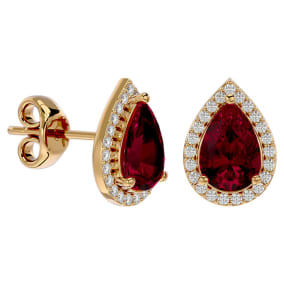 3 1/3 Carat Ruby and Diamond Pear Shape Stud Earrings In 14 Karat Yellow Gold