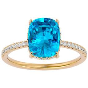 3 3/4 Carat Antique Cushion Shape Blue Topaz and Hidden Halo Diamond Ring In 14 Karat Yellow Gold
