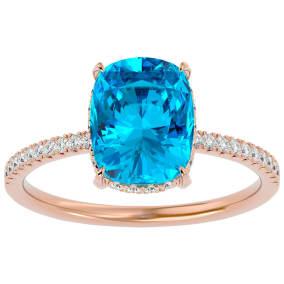 3 3/4 Carat Antique Cushion Shape Blue Topaz and Hidden Halo Diamond Ring In 14 Karat Rose Gold