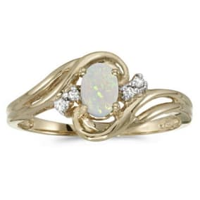 1/4ct Flowing Oval Opal And Diamond Ring in 14k Yellow Gold