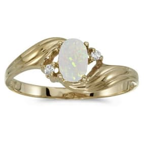 1/4ct Oval Opal And .03ct Diamond Ring in 14k Yellow Gold